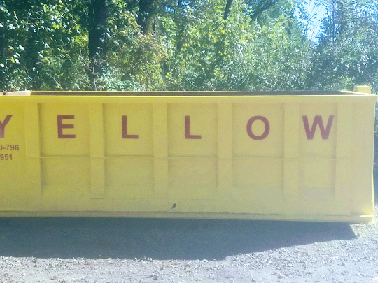 yellow dumpster in baltimore